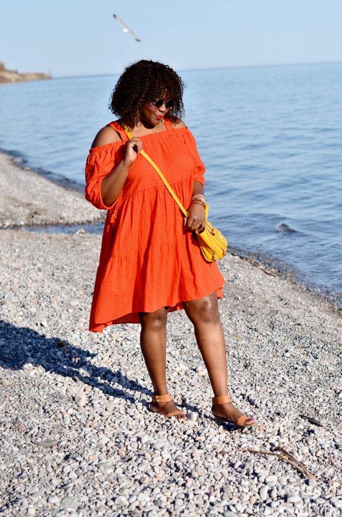 Plus size blogger wearing H&M plus. Orange Off the shoulder dress- Assa Cisse